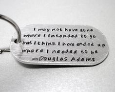 This Douglas Adams keychain. | 28 Literary Accessories All Book Lovers Must Have