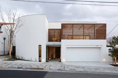 Built by Edward Suzuki Associates in Yokohama-shi, Japan with date 2012. Images by Yasuhiro Nukamura. This residence is for a family of four with a private Studio/Office attached for the husband. Located on the bluff of...