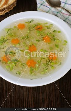 Chicken vermicelli soup with green peas stock photo