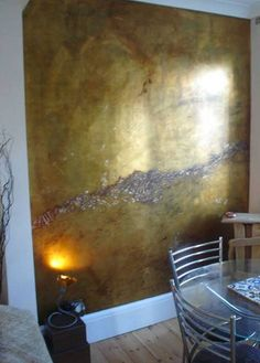 Home Design and Decor , Interior Metallic Paint Wall : Dining Room With Gold Metallic Paint Wall And Hardwood Floor