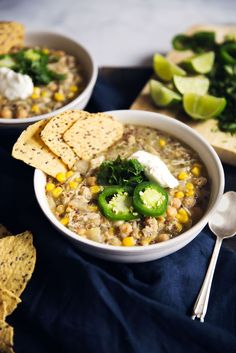 A healthy slow cooker salsa verde chicken chickpea chili with quinoa & lots of lime flavor. Serve with tortilla chips, avocado & greek yogurt!