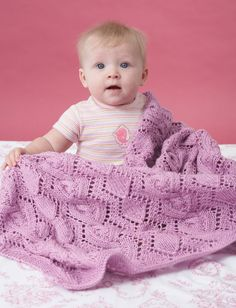 Free knitting pattern for cable and lace baby blanket in sport yarn diamond lace pattern with complementary cable