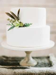 Love this simple wedding cake with feathers!