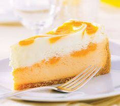This month Ginsberg's foods is featuring an Orange Creamsicle Cheesecake from Sweetstreet. Smooth white chocolate cheese is layered on a creamy orange-infused cheesecake vibrantly swirled . Köstliche Desserts, Summer Desserts, Delicious Desserts, Dessert Recipes, Yummy Food, Yummy Yummy, Yummy Eats, Trifle, Cheesecakes