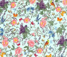 """Michael Miller fabric """"At the Conservatory"""". All the colors of the rainbow; red, orange, yellow, green, blue, purple as well as pink and white on a mint/aqua background."""