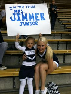 """At the BYU game, Jimmer Fredette's fiance Witney came up into the stands to get a picture with Hallie and her sign. Hallie was in heaven. Afterward, she told me """"I want to be a cheerleader here when I get big."""""""