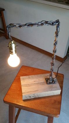 Welded chain table lamp