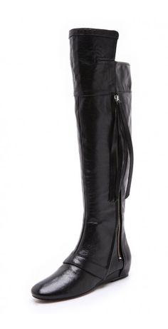 LODEN CUFF TALL BOOTS $123.41 A fixed cuff follows the curve of the shaft on smooth leather 10 Crosby Derek Lam boots, styled with an asymmetrical top line. A tassel details the zipper pull, and a slim, wedge heel offers subtle lift. Leather sole.
