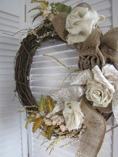 #Burlap roses with map detailed ribbon on #grapevine #wreath  www.facebook.com/wreathswithareason