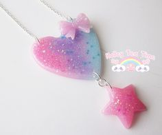 Prism galaxy heart necklace is a new necklace into the fairy galaxy collection.     Made from durable resin and multiple pastel colors with glitter and stars. The heart has a cute pink bow on the right side of the heart and a  star at the bottom. You are sure to feel like a magical fairy with thi...