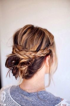 An easy way for shorter-haired girls to do a chic updo. Using two small strands from the front, braid your hair, and pin together at the back to make a crown. Pin your remaining hair in small sections for a faux chignon. via StyleListCanada