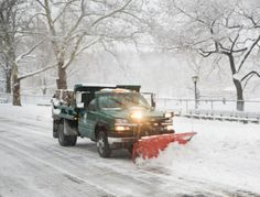 Snow plow truck clearing road