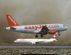 The fire was very close to the fence; you can even see some flames behind Swiss A321. EasyJet Airline - Airbus A319-111. Malaga (Spain).