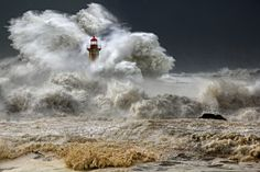 Lighthouse Picture -- Storm Wallpaper -- National Geographic Photo of the Day Lighthouse, Portugal Photograph by Veselin Malinov This Month in Photo of the Day: National Geographic Photo Contest Images A huge ocean storm, Porto, Portugal, January 2013 Photos Du, Cool Photos, Amazing Photos, Amazing Places, Stürmische See, Photo Voyage, Lighthouse Pictures, Stormy Sea, Stormy Waters