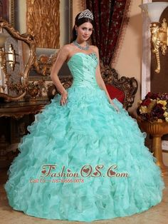 Modest Apple Green Quinceanera Dress Sweetheart  Organza Beading and Ruffles Ball Gown http://www.fashionos.com The elegance of this strapless aqua green Quinceanera gown knows no bounds! Its fitted bodice boasts a charming corset-style design with diagonal ruchings and intricate embellishments of crystals and rhinestones. It`s all topped off by a sweetheart neckline. Meanwhile, its full, A-line skirt is festooned with dramatic ruffles that flows gorgeously to the floor.