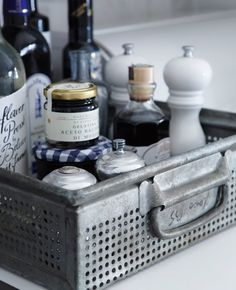 store oils and vinegars in a vintage tray