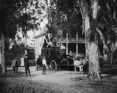 1900 - Views of San Pedro - Tree-shaded residence of Phineas Banning in Wilmington. In front is a mule-drawn coach piled high with people. Courtesy: Los Angeles, Water and Power Associates, Inc. Whittier, CA (USA) California History, California Love, Southern California, Wilmington California, Occidental Hotel, Harbor City, San Luis Obispo County, Los Angeles County, Historical Society