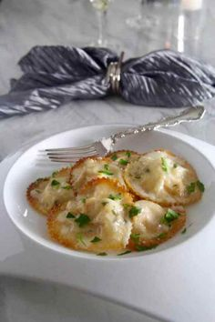 Sheet pan BAKED won ton Lobster Ravioli in a Lemon Butter Cream Sauce can be made quickly and easily by using won ton wrappers and baked in the oven!