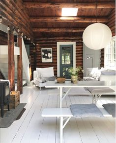 my scandinavian home: Could This Hygge Danish Log Cabin Be Your Holiday Home? L… my scandinavian home: Could This Hygge Danish Log Cabin Be Your Holiday Home? Living room with white floors and wood walls. Simple Dining Table, Rustic Stools, Rustic Home Interiors, Modern Cabin Interior, Log Cabin Homes, Rustic Cottage, Rustic Barn, Scandinavian Home, Home Decor