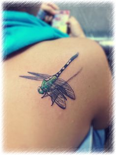 Amazing dragonfly tattoo! Awesome!