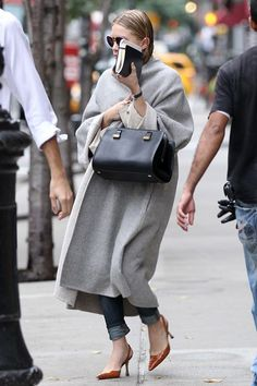 15 Ways To Do New York City Like An Olsen Twin #refinery29  http://www.refinery29.com/olsen-twins-nyc-pictures#slide-11  When: October 2011Where: TribecaLeaving her Tribeca apartment, Ashley takes on the fall in a grey blanket coat, skinny jeans, orange Manolo Blahniks (one of her favorite pairs of shoes), and a black The Row bag. Plus, we've never seen anyone who can rock wet hair this good.