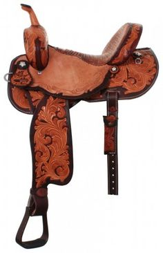 3/4 Whirlwind Tooled Pozzi Pro Barrel Racer with Cognac Dyed Background and Edging, Vintage Cognac Caiman Gator Seat, Leather Horn, Adjustable 3 way in skirt rigging, Fleece Lined Skirt, Engraved Aluminum Stirrups, and Pozzi Flower Iron Sterling Conchos
