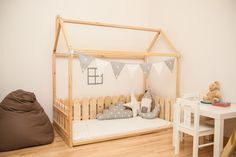Crib size house bed with fence / bed house / kid's nursery bed / wooden house bed / Montessori nursery by SweetHOMEfromwood on Etsy https://www.etsy.com/listing/252226132/crib-size-house-bed-with-fence-bed-house