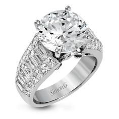 Crafted from 18k white gold, this modern engagement ring commends attention with 1.34 ctw of princess cut diamonds in combination with 1.42 ctw of baguette diamonds.