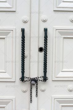 Locked and chained white doors ...  aged, ancient, antique, background, black, chains, close, door, doors, entrance, front, grunge, handle, handles, home, house, key, lock, metal, nobody, old, paint, rustic, victorian, vintage, white, wood, wooden