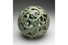 One of Diane KW's intricately carved ceramic spheres. Photo credit: Cory Lum