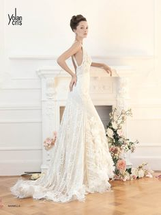 I love the shape of this dress, the dramatic cut and exposed back is phenom! Marbella wedding dress by YolanCris http://www.bridaldreamdress.com/yolancris-bridal-collection-divas-wedding-dress-marbella.html