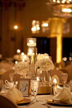 A mix of candles and florals at the President Hotel by Blue Bouquet, www.bluebouquet.com