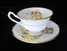 "Royal Albert Primulette Tea Cup & Saucer, c1950s. Cup: 4-3/4"" x 2½"" tall. Saucer: 5½"". A third style of tea cup issued in this pattern? This is in gold trim and nothing else is.  Also does not say Primulette on the bottom.  Not sure that this is Primulette. $20.82/Pr at nevergetsoldshop on ebay, 3/13/16"