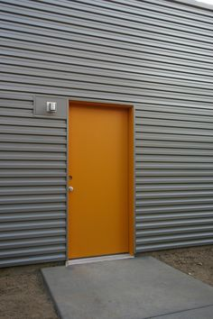Decorate Exterior Using Corrugated Metal Siding For Residential Home: Corrugated Metal Siding With Entry Door And Exterior Wall Lighting For Exterior Design Steel Siding, Steel Cladding, House Siding, Facade House, Modern Exterior, Exterior Design, Factory Architecture, Tin House, Corrugated Metal