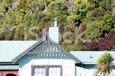 Traditionally New Zealand style Villa Gable with Ti Kouka Tree royalty-free stock photo