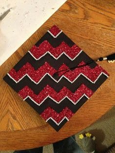 "Graduation Cap with rhinestones on the edge of the chevron  use red and yellow glitter paper, leave middle blank ""UMD class of 2014"" ""JBL"""