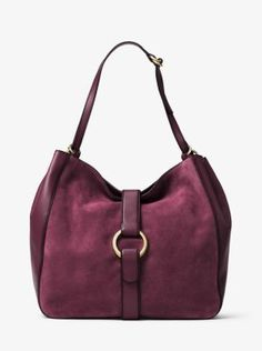 Designed as a modern day interpretation of boho chic, the Quincy Shoulder Bag is a sophisticated nod to the season's '70s spirit—from festival grounds to the workplace. The slouchy hobo silhouette showcases a single center grommet for a refined take on iconic hardware. A rich mix of smooth leather and sumptuous suede reveal a tactile nature, while artisanal burnished edges give unique character to the seams of the bag.