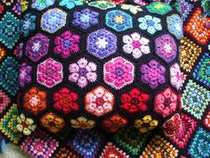 African flowers crochet cushion. I feel drawn to these colours.