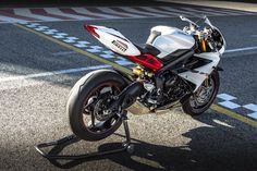 The 675 roundly stuffing the Jap fours at last in Supersport tests. A Triumph.