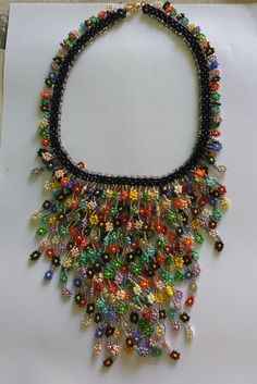 Seed bead necklace with Daisy Seed Bead Necklace, Seed Bead Jewelry, Diy Necklace, Beaded Jewelry, Jewelry Knots, Fabric Jewelry, Jewelry Crafts, Handmade Necklaces, Handcrafted Jewelry