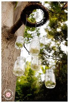 What a good idea! Use a grapevine wreath to dangle jars. This has potential to being a cool rustic chandelier..