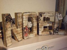 Noel letters made with cardboard, glue and old music sheets dyed with tea to make the aged look- can be turned into the word LoVe when the season is over! :)