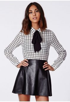 This sassy little pussybow blouse is a perfect addition to your work wear wardrobe. The monochrome palette and cute bow detailing is ideal for AW14. Style with skinny black jeans and strappy heels.   Detachable bow  Approx length 69.5c...