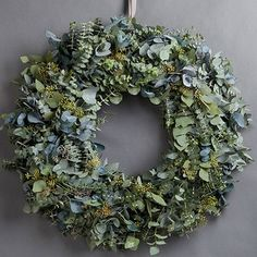 MIXED EUCALYPTUS WREATH - This beautiful wreath, made of eucalyptus, is the perfect modest door decoration. The wreath includes baby blue, silver dollar and flowering eucalyptus. Christmas Door Wreaths, Christmas Flowers, Natural Christmas, Beautiful Christmas, Christmas Crafts, Eucalyptus Wreath, Xmas Decorations, Wedding Decoration, Wild Hearts