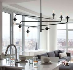 Atelier Chandelier by Sonneman Lighting 6 lights: diam 42 inch: around 850$ 8 lights: diam 60inch WAY to big