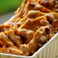 This is a wonderful peanut brittle that is easy to make and wows everyone! Have all the ingredients for this recipe measured out and ready. This recipe requires that you react quickly. You do not have time to measure ingredients in between steps. Homemade Peanut Brittle, Peanut Brittle Recipe, Brittle Recipes, Candy Recipes, Holiday Recipes, Dessert Recipes, Holiday Baking, Christmas Baking, Christmas Goodies