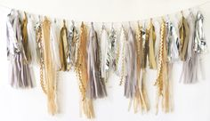 Tassel Garland in Fancy Neutrals, FREE SHIPPING, Tan, Silver, Taupe, Gold, White, Gray by CarouselLane on Etsy https://www.etsy.com/listing/163338815/tassel-garland-in-fancy-neutrals-free