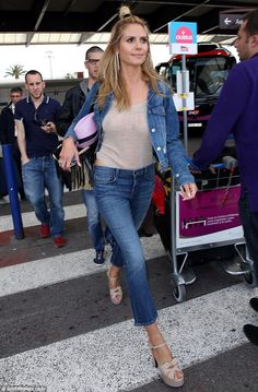 Raunchy runway: Heidi Klum left little of her famous assets to the imagination as she went braless while strolling through Nice Airport on Friday