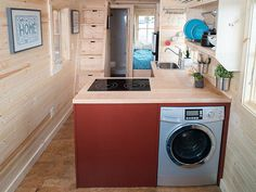 What a great option for a laundry space in a tiny house, using space that…