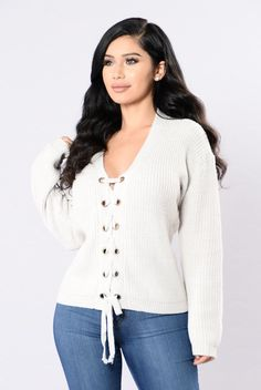 - Available in Ivory and Marsala - V Neckline - Long Sleeve - Lace Up Front - 55% Cotton, 45% Acrylic